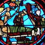 Le mauvais riche accueilli par deux diables. Vitrail de la cathédrale de Bourges.